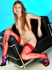 Garbed in sexy red lingerie with thigh-high stockings and strappy stiletto sandals, with explicit and intimate poses, Jo's evocative poses and sensual allure makes this a series to remember.