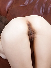 Erika rests her sexy hairy body on the couch